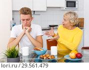 Купить «Sad son and unhappy mother quarrelling», фото № 29561479, снято 25 октября 2018 г. (c) Яков Филимонов / Фотобанк Лори