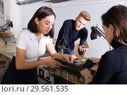 Female student engaged in architectural modeling with groupmates. Стоковое фото, фотограф Яков Филимонов / Фотобанк Лори