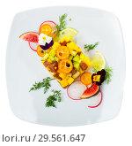 Купить «Delicious tartare of tuna with mango, avocado and fig, served with flower», фото № 29561647, снято 19 декабря 2018 г. (c) Яков Филимонов / Фотобанк Лори