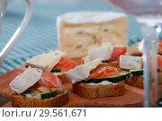 Купить «Canapes with salmon and cambozola», фото № 29561671, снято 24 января 2019 г. (c) Яков Филимонов / Фотобанк Лори