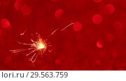 Купить «Sparkler and Christmas or New Year background», видеоролик № 29563759, снято 13 декабря 2018 г. (c) Сергей Петерман / Фотобанк Лори