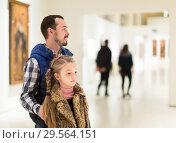 Купить «Adult man and daughter enjoying expositions», фото № 29564151, снято 14 декабря 2018 г. (c) Яков Филимонов / Фотобанк Лори