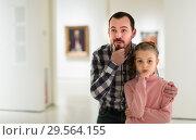 Купить «Young man and daughter exploring paintings», фото № 29564155, снято 14 декабря 2018 г. (c) Яков Филимонов / Фотобанк Лори