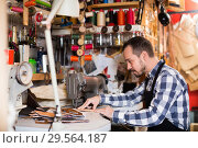 Купить «Professional man worker working on stitches for belt», фото № 29564187, снято 20 января 2019 г. (c) Яков Филимонов / Фотобанк Лори
