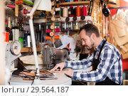 Купить «Professional man worker working on stitches for belt», фото № 29564187, снято 22 марта 2019 г. (c) Яков Филимонов / Фотобанк Лори