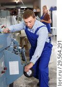 Купить «Ordinary male working in workroom», фото № 29564291, снято 10 сентября 2018 г. (c) Яков Филимонов / Фотобанк Лори