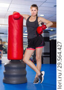 Купить «Portrait of young woman boxer with punching bag», фото № 29564427, снято 21 августа 2017 г. (c) Яков Филимонов / Фотобанк Лори