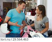 Купить «Happy couple is choosing modern motobikes», фото № 29564463, снято 8 мая 2018 г. (c) Яков Филимонов / Фотобанк Лори