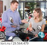 Купить «Man with woman are choosing modern motobikes», фото № 29564479, снято 8 мая 2018 г. (c) Яков Филимонов / Фотобанк Лори