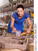 Купить «female customer taking сereals with scoop from basket in eco market», фото № 29564591, снято 13 июня 2017 г. (c) Яков Филимонов / Фотобанк Лори