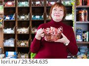 Купить «woman buyer choosing sweet candies», фото № 29564635, снято 15 декабря 2017 г. (c) Яков Филимонов / Фотобанк Лори