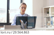 Купить «businesswoman with laptop working at office», видеоролик № 29564863, снято 10 декабря 2018 г. (c) Syda Productions / Фотобанк Лори