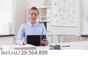 Купить «businesswoman with tablet computer works at office», видеоролик № 29564899, снято 10 декабря 2018 г. (c) Syda Productions / Фотобанк Лори