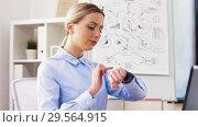 Купить «businesswoman with laptop and smartwatch at office», видеоролик № 29564915, снято 10 декабря 2018 г. (c) Syda Productions / Фотобанк Лори
