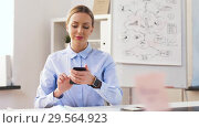 Купить «businesswoman with smartphone and smart watch», видеоролик № 29564923, снято 10 декабря 2018 г. (c) Syda Productions / Фотобанк Лори