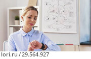 Купить «businesswoman with smartphone and smart watch», видеоролик № 29564927, снято 10 декабря 2018 г. (c) Syda Productions / Фотобанк Лори