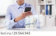 Купить «businesswoman with smartphone working at office», видеоролик № 29564943, снято 10 декабря 2018 г. (c) Syda Productions / Фотобанк Лори