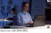Купить «businesswoman with laptop working at night office», видеоролик № 29564983, снято 10 декабря 2018 г. (c) Syda Productions / Фотобанк Лори