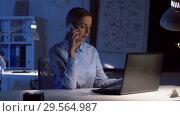 Купить «businesswoman calling on smartphone at dark office», видеоролик № 29564987, снято 10 декабря 2018 г. (c) Syda Productions / Фотобанк Лори