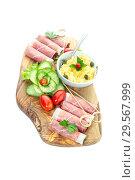 Купить «Pieces of Italian prosciutto on a wooden cutting board», фото № 29567999, снято 12 декабря 2018 г. (c) Татьяна Ляпи / Фотобанк Лори