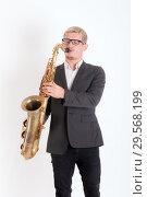 Купить «Portrait of a saxophonist», фото № 29568199, снято 24 сентября 2012 г. (c) Argument / Фотобанк Лори