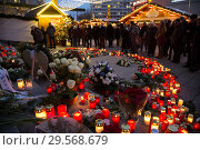 Купить «Germany, Berlin - Commemoration of the victims of the terrorist attack at Christmas Market Breitscheidplatz (Gedaechtniskirche) 2016», фото № 29568679, снято 20 декабря 2017 г. (c) Caro Photoagency / Фотобанк Лори