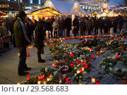 Купить «Germany, Berlin - Commemoration of the victims of the terrorist attack at Christmas Market Breitscheidplatz (Gedaechtniskirche) 2016», фото № 29568683, снято 20 декабря 2017 г. (c) Caro Photoagency / Фотобанк Лори