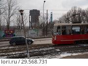 Купить «Poland, Bytom - tram and car, behind the winding tower of the disused KWK Szombierki colliery», фото № 29568731, снято 28 февраля 2018 г. (c) Caro Photoagency / Фотобанк Лори