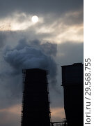 Купить «Poland, Bytom (Bytom) - Sun darkened by emissions from the Carbo coke coking plant», фото № 29568755, снято 28 февраля 2018 г. (c) Caro Photoagency / Фотобанк Лори