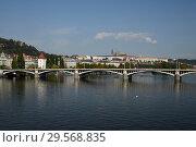 Prague, Hlavni mesto Praha, Czech Republic - Moldova and Prague Castle. City view with the Jirasek bridge and the Lesser Town. (2018 год). Редакционное фото, агентство Caro Photoagency / Фотобанк Лори