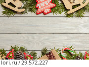 White wooden christmas background with fir branches, cones, decor, top view, copyspace. Стоковое фото, фотограф Максим Бейков / Фотобанк Лори