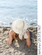 Купить «Closeup of young woman in swimsuit and hat taking sunbath», фото № 29573167, снято 10 июля 2018 г. (c) Яков Филимонов / Фотобанк Лори