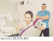 Купить «Girl showing thumb up in dental clinic», фото № 29573451, снято 1 марта 2018 г. (c) Яков Филимонов / Фотобанк Лори