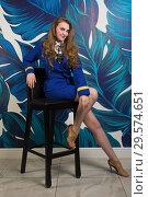 Купить «Pinup girl in suit of stewardess», фото № 29574651, снято 9 августа 2018 г. (c) Дмитрий Черевко / Фотобанк Лори