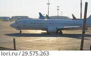 Купить «Official spotting, Utair Aircraft performs taxiing before takeoff», видеоролик № 29575263, снято 1 августа 2018 г. (c) Андрей Радченко / Фотобанк Лори
