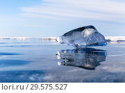 Купить «Lake Baikal in winter. Transparent blue icicle frozen in smooth, clean ice. Natural cold background. Free space for text», фото № 29575527, снято 21 марта 2015 г. (c) Виктория Катьянова / Фотобанк Лори