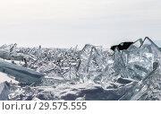 Купить «Lake Baikal in winter. Silhouette of a car in a ice hummocks field among transparent big ice blocks. Winter auto travel», фото № 29575555, снято 8 марта 2014 г. (c) Виктория Катьянова / Фотобанк Лори