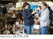 Купить «Senior man and woman at traditional flea market», фото № 29576239, снято 23 октября 2017 г. (c) Яков Филимонов / Фотобанк Лори