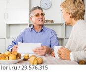 Купить «couple at table attentively study documents», фото № 29576315, снято 22 января 2019 г. (c) Яков Филимонов / Фотобанк Лори