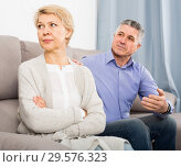 annoyed mature couple quarreling at home with each other. Стоковое фото, фотограф Яков Филимонов / Фотобанк Лори