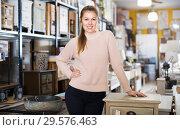 Купить «Female choosing commode in store», фото № 29576463, снято 15 ноября 2017 г. (c) Яков Филимонов / Фотобанк Лори