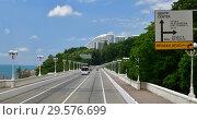 Купить «Sochi, Russia - June 2 2018. Traffic on A-147 highway along Black Sea», фото № 29576699, снято 2 июня 2018 г. (c) Володина Ольга / Фотобанк Лори