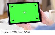 Купить «hands holding tablet pc with green screen at home», видеоролик № 29586559, снято 17 января 2020 г. (c) Syda Productions / Фотобанк Лори
