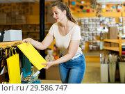 Купить «Woman demonstrates multi colored bags», фото № 29586747, снято 19 апреля 2017 г. (c) Яков Филимонов / Фотобанк Лори