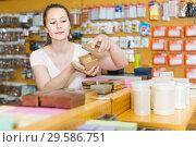 Купить «Woman choosing other gift boxes smiling», фото № 29586751, снято 19 апреля 2017 г. (c) Яков Филимонов / Фотобанк Лори