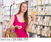 Купить «Woman take a choise shampoo», фото № 29586791, снято 2 мая 2017 г. (c) Яков Филимонов / Фотобанк Лори