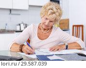 Купить «Woman put in order documents», фото № 29587039, снято 11 июля 2018 г. (c) Яков Филимонов / Фотобанк Лори