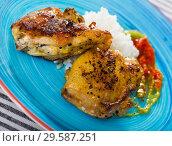 Купить «Baked chicken thighs and rice with sauces», фото № 29587251, снято 23 июля 2019 г. (c) Яков Филимонов / Фотобанк Лори