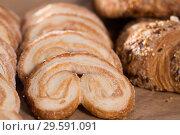 Купить «fried Palmier laid out on counter», фото № 29591091, снято 30 января 2018 г. (c) Татьяна Яцевич / Фотобанк Лори