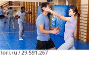 Купить «People practicing self defense techniques», фото № 29591267, снято 31 октября 2018 г. (c) Яков Филимонов / Фотобанк Лори